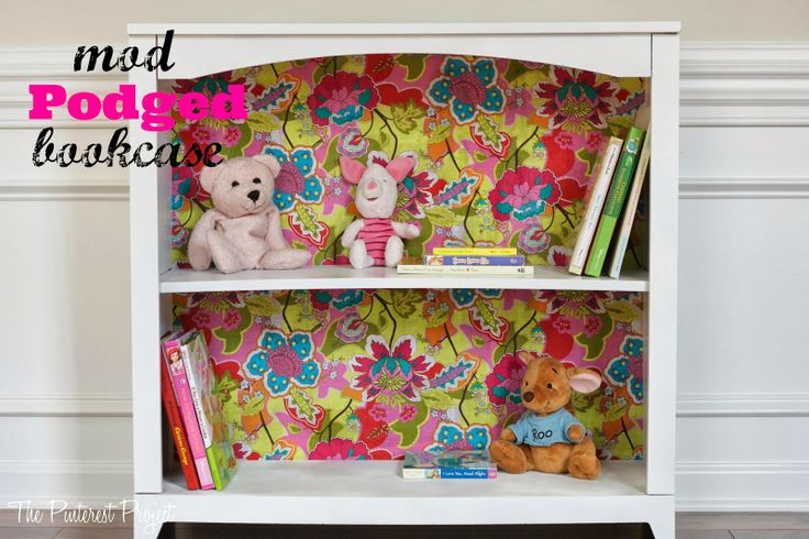 Mod Podge Bookcase, I would use a different fabic, but great idea!