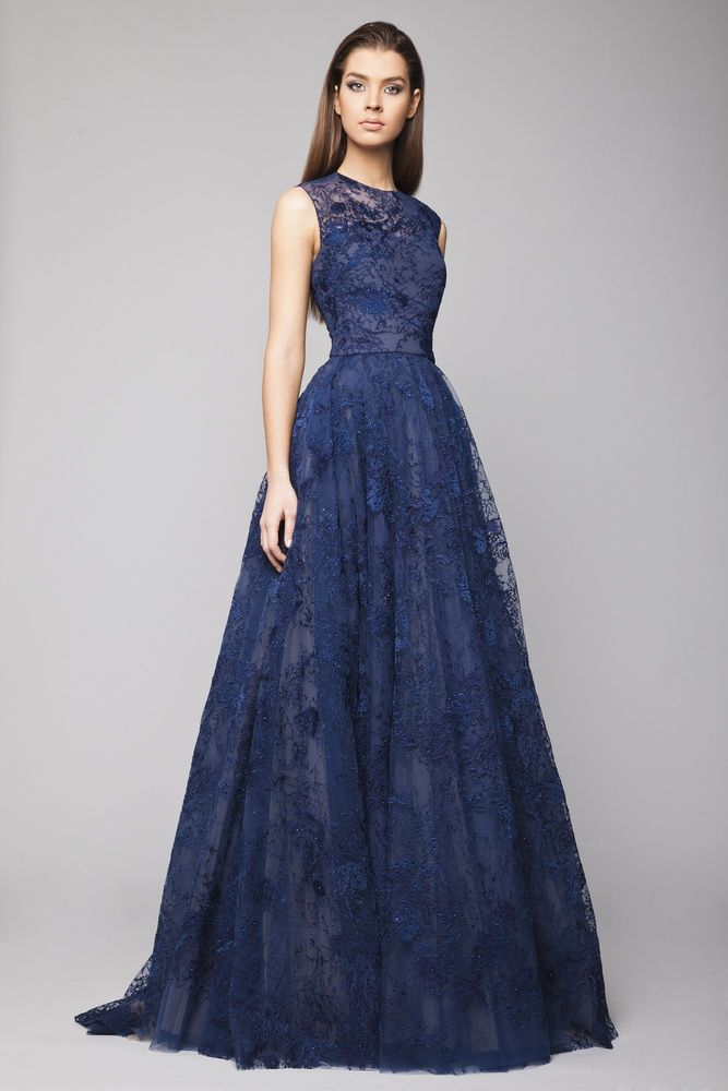 Navy Lace Ball gown with delicate crystal embroideries in shades of Blue and sheer overlay bodice.