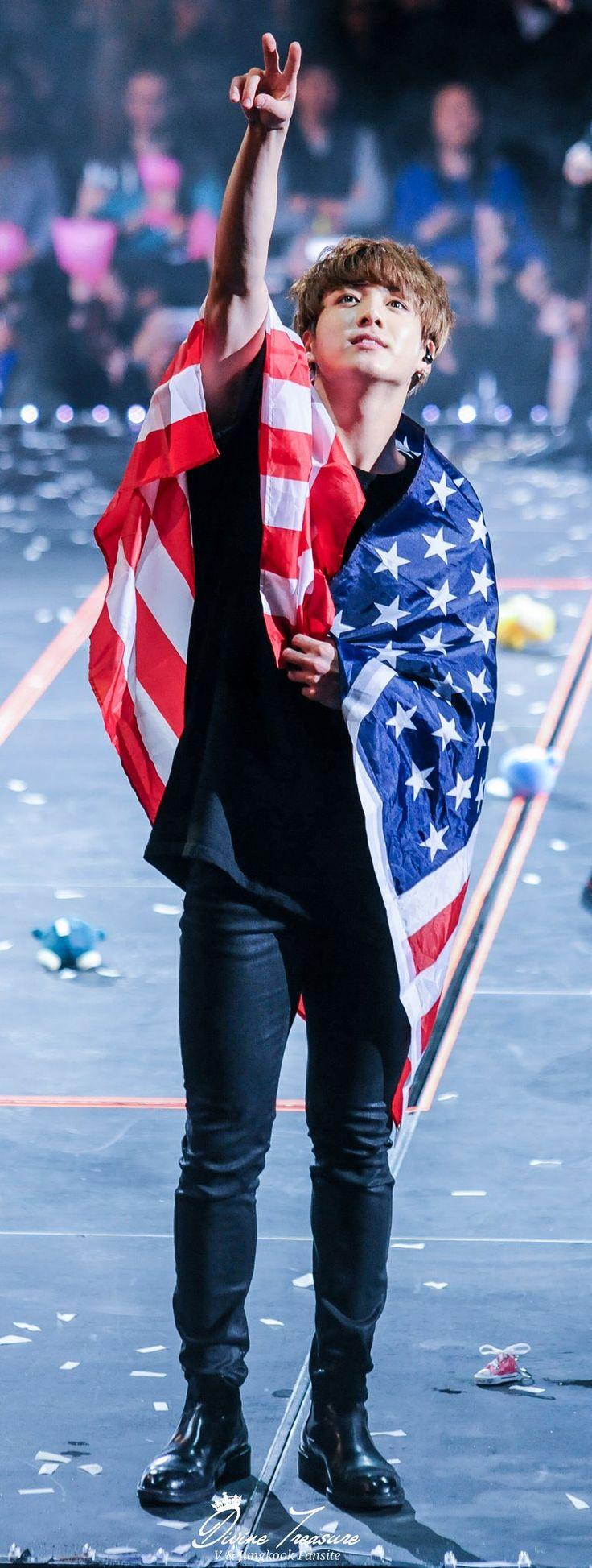 Jungkook é o garoto de segurar as bandeiras do país lol