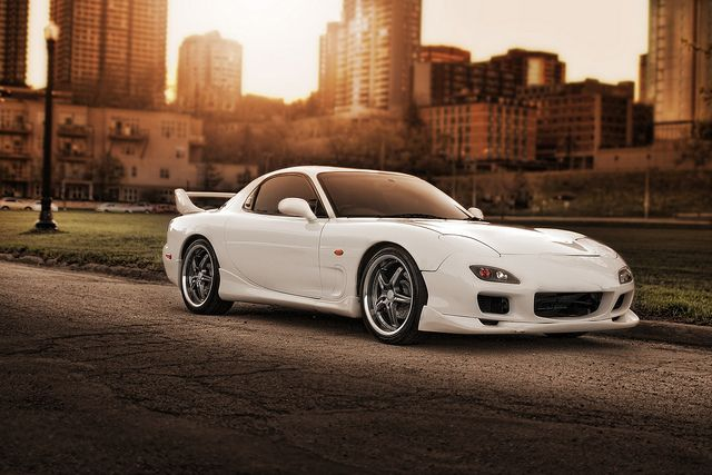 A Mazda RX-7 in white - gorgeous in the sunset