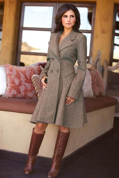 A thoroughbred classic houndstooth coat sports a double-breasted front, lapel, tortoise buttons, flounced skirt, and functional corset back.