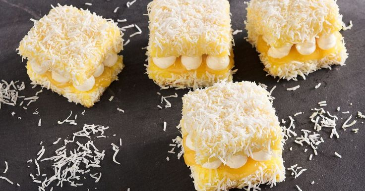 These deliciously light lemon meringue lamingtons (or lemingtons as we like to call them) are filled with tangy lemon curd and creamy meringue buttercream and coated in shredded coconut.