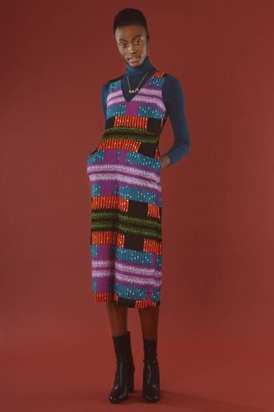 Must-have contemporary fashion jumpsuit with wide legs, V neck and side pockets for women who love fair trade fashion. Kente Inspired Exclusive Prints from Africa.