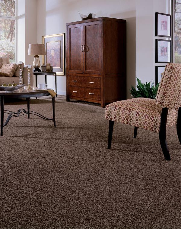 TWIST. In a room full of neutrals, the texture of a twist carpet creates interest.