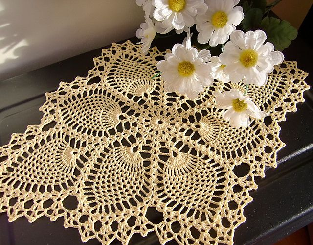 Pineapple Doily, crochet pattern free on Ravelry.   This one is just georgeous!