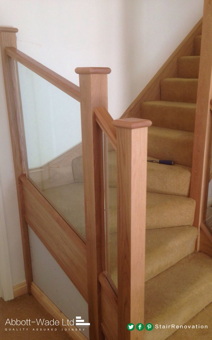 Abbott-Wade oak staircase with inline glass balustrade.