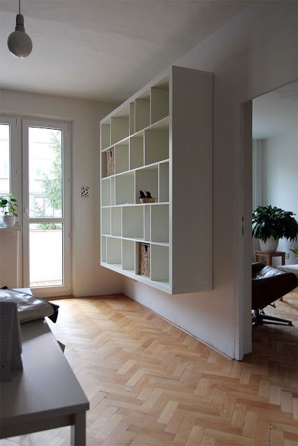 Love that this is just an Ikea EXPEDIT with the shelves shuffled around and wall mounted. It looks so expensive