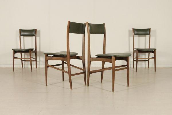 Gruppo di quattro sedie anni 50; legno di faggio, imbottitura in espanso, rivestimento in skai. Buone condizioni, presentano piccoli segni di usura. Altezza seduta: 44
