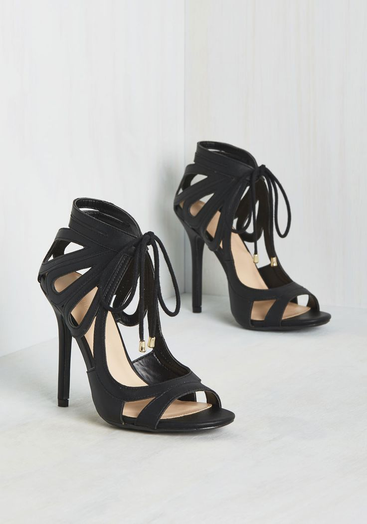 Confidently clad in these faux-leather pumps, you enter the fete with a 'je ne sais quoi' your pals are hot to decipher. Smiling coyly, you watch them examine your look, and notice that they pause the longest at the drop-shaped cutouts of your black heels. Looks like the mystery is solved!