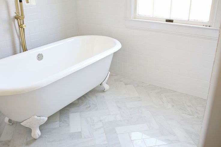 This shows a herringbone marble-ish floor next to the cross hatch pattern using white subway. Could do something similar in guest bath.