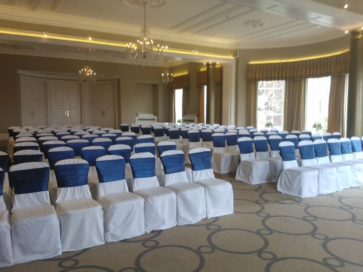 Blue satin sashes on white chair covers
