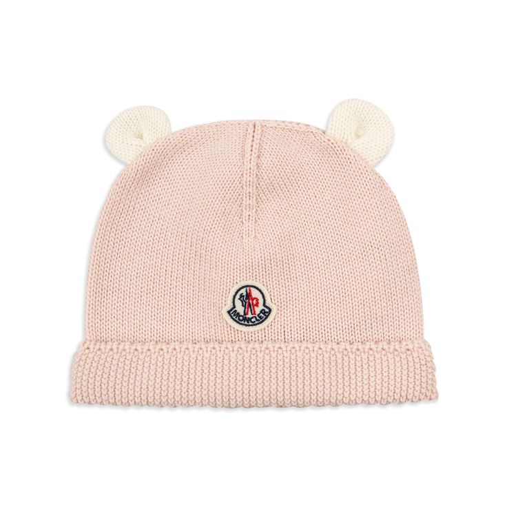 base MONCLER Baby Girls Ear Beanie Hat - Pink Baby girls beanie hat • Soft knitted wool • Turn up brim • Signature logo motif • Attached little ears • Made in ItalyMaterial: 100% Wool • Code: MOAM/GIRL
