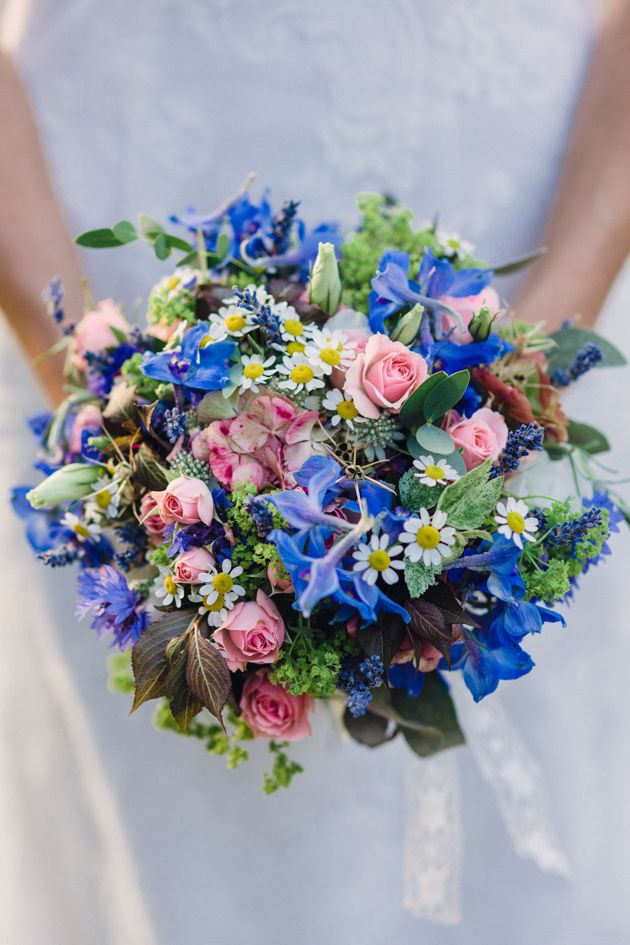wildflower bouquet featuring a mix of lisianthus, roses, asters, larkspur, rosemary, purple sage, hydrangea and allium seed heads , little daisies, alchemilla mollis and cornflower