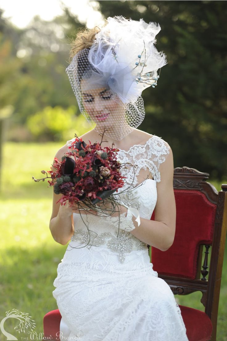 "Jyselle carries a bold red bouquet of ""hot chocolate"" calla lilies, spider orchids, tulips, spiky berry and cordyline foliage wrapped in a nest of dodda vine. In a display of sophistication yet tempered wildness, this unique statement bouquet was voted favourite for the day!  http://www.thewillowbranch.com.au/farmstead-part-2-2/"