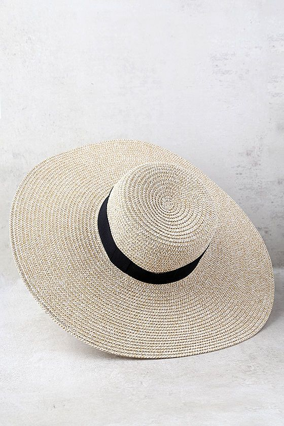 """The I Feel Love Beige Floppy Straw Hat is evoking all kinds of admiration wherever it goes! Flat top straw hat is accented by a black grosgrain ribbon (tied in a bow) above the floppy 5.5"""" brim. White elastic band helps keep hat secure. 21"""" interior circumference."""