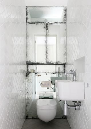 Small bathroom. Love the mirrors, also that it's not 'perfect'