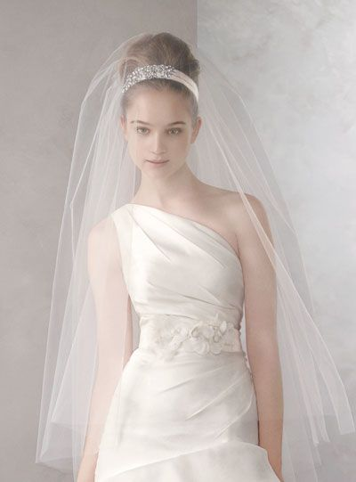 Traditional doesn't need to mean boring, as evidenced by this beautiful two-tier walking length veil from White by Vera Wang. Two layers of raw edge tulle provide an ethereal addition to your wedding look. At David's Bridal, Manchester.