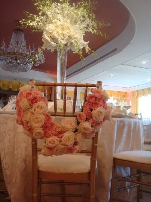 I LOVE THE ROSE GARLAND ON THE CHAIRS...BREATHTAKING!