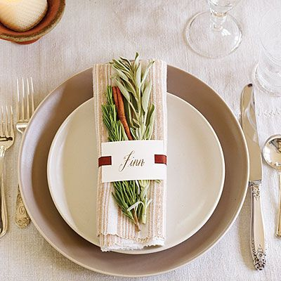 Create timeless place settings with herbs.    Another simple plate set up. I like the colors a lot too.