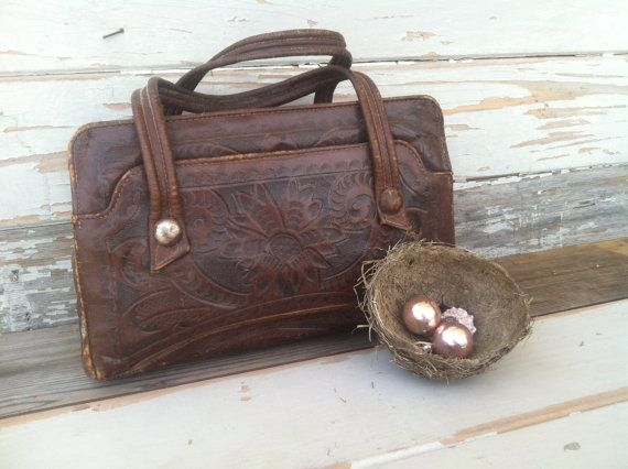 Check out this item in my Etsy shop https://www.etsy.com/listing/188846026/hand-tooled-leather-purse-on-sale