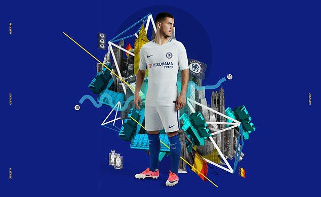 Eden Hazard models the new away kit which has been revealed with both blue and white socks