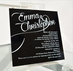 """Enchanting Black"" is a modern acrylic invitation printed with white font on black background and showcasing the wedded couple to be in an elegant cursive font   This wonderful ""Acrylic Wedding Invitation"" is available in various sizes and is also available in a variety of font styles and colours We are located in Melbourne, Australia and can deliver worldwide. Note:  minimum quantities apply with some of our acrylic invitations."
