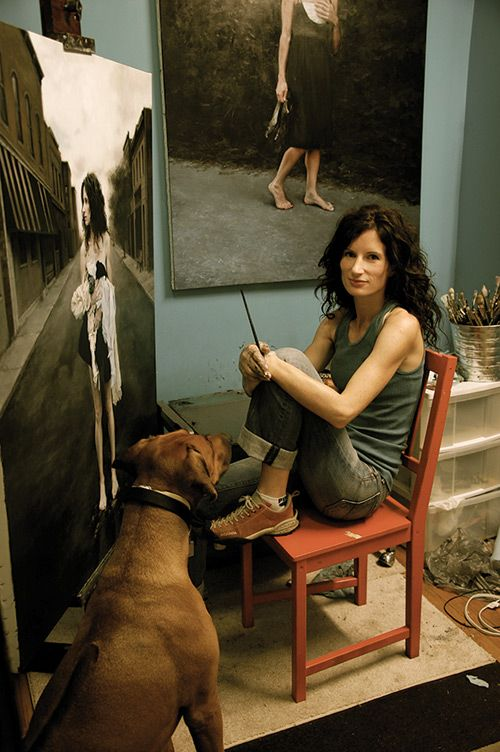 Photo of Katie O'Hagan in her studio with her dog, Seamus.
