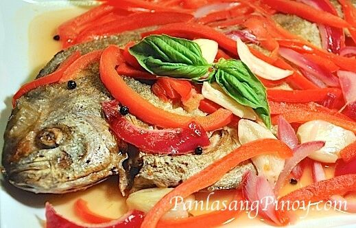 Fish Escabeche is a type of sweet and sour fish recipe. There are many version of Escabeche around. This version that we have here is probably the most simple of all. However, the taste will not be as simple as it seems because this recipe has all the good flavors in it.