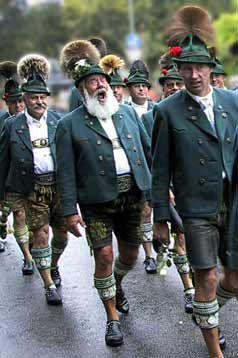 Bavaria - volk costumes (Trachten). Traditional Lederhosen worn by Bavarian country men during a procession.