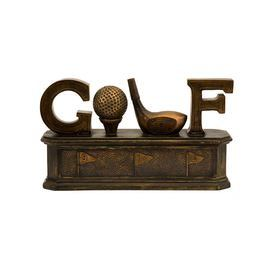 """Trinket box with a golf-inspired typographic motif.   Product: Trinket boxConstruction Material: Calcium carbonate and polyresinColor: BronzeFeatures:  Features a golf ball and club as the O and L Opens for storage Dimensions: 7"""" H x 12"""" W x 3.5"""" D"""