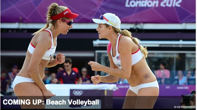 409e: Leaning in towards each other, these two female volleyball players are shown to be in deep discussion about their game plan during the game, this leaves fans anticipating what these athletes next move will be.