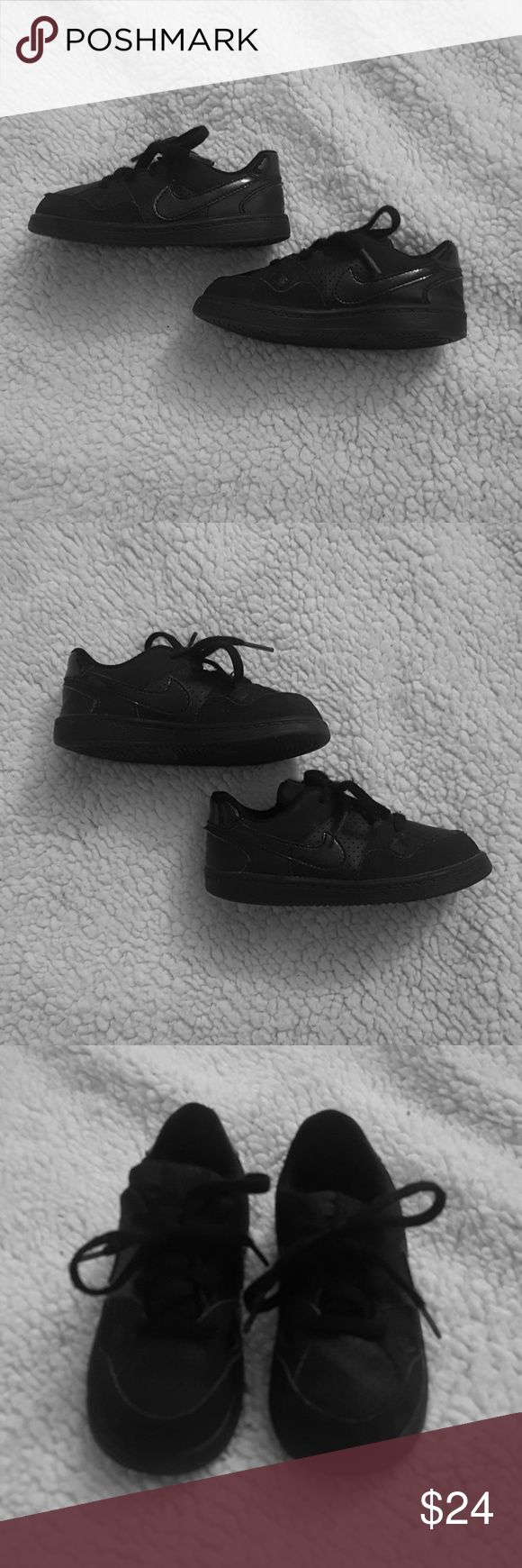 Toddler Size 8c Black Nike Air Force One Sneakers Size 8c   Pre-owned. Bottom of right sole is slightly bent. Seen in picture.   Still in good condition Nike Shoes Sneakers