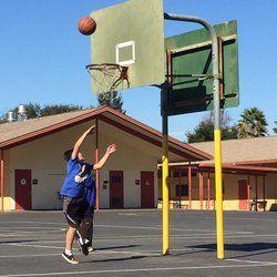 Spacious Blacktop and Basketball hoops at Almond Elementary.