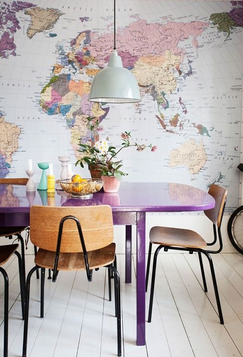 Retro vintage dining room with world map wallpaper