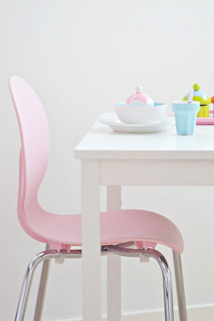 The pink accent of this dining chair works perfectly with white.