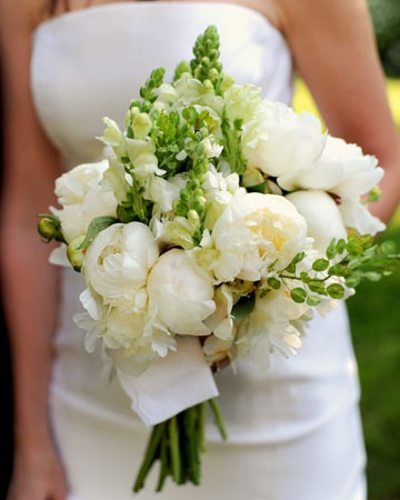 White peony bouquet with green accents.