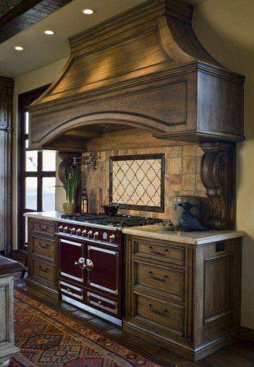 this is a great way to take something from a kitchen and carry it into another room, the wooden hood would look very vintage over a smaller fireplace and by adding columns to each side in black or gray, you can create a focal point, this would be great for a fireplace that you are planning to mount a flat screen television: Decor, Stove, House Ideas, Mediterranean Kitchen, Kitchen Design, Rysso Peters, Kitchen Ideas, Dream Kitchens