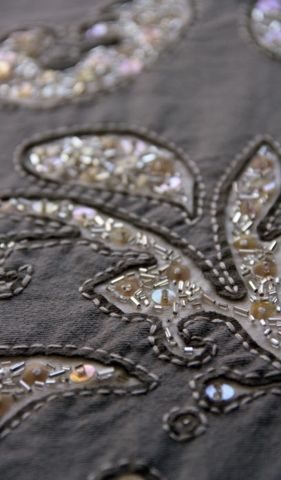 Reverse applique with sequins and beads