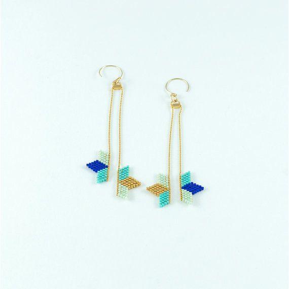 Boucles d'oreille plaquées or et tissage de demi étoile bleu doré turquoise en…