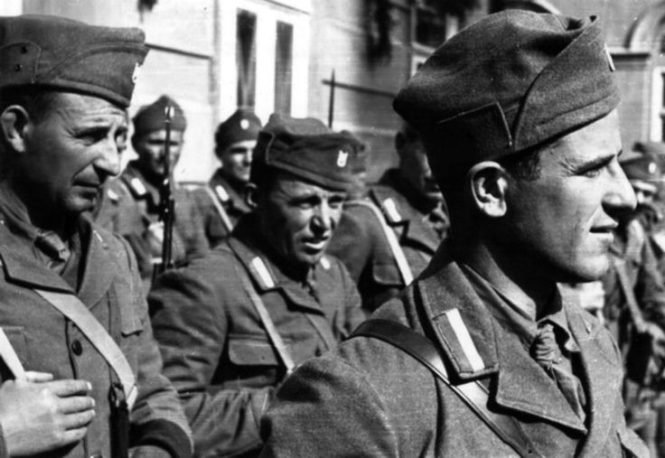 "Fascist Croatian soldiers of the Axis-created puppet state of the Independent State of Croatia gather in Zagreb shortly following the state's creation on 10 April 1941 following the invasion of Yugoslavia by the Axis powers and led by Ustaše member Ante Pavelić. The movement emphasized the need for a racially ""pure"" Croatia and promoted genocide against Serbs, Jews and Romani people. Fiercely nationalistic, the Ustaše were also fanatically Catholic. Zagreb, Yugoslavia. 15 April 1941."
