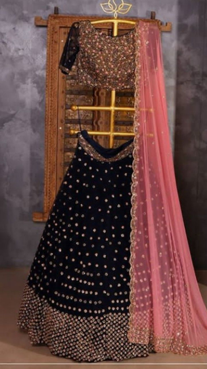 4c0d5f3837 Beautiful Hand Embroidered Velvet Lehenga-Choli with superb embellishments.  Matched with gajri dupatta. Superb detailing and combination of black and  gajri ...
