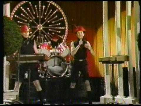 """In their second Fridays appearance, Devo performs """"Whip It"""", live.  Introduction by Jack Burns."""