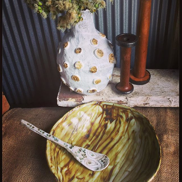 A big vase with buttons and a bowl & spoon that match perfectly....Rustic!