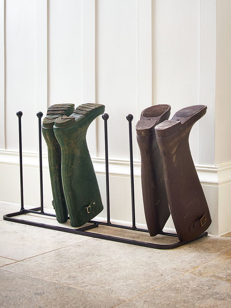 An essential for any hallway or porch, our classic four-pair boot rack is the perfect tool for storing muddy boots of all sizes. Made from durable and weather resistant cast iron, each rack includes eight high spokes with rounded ends and an oblong base that's sturdy but can be placed against a wall. Short on space? Take a look at our Two Pair Metal Boot Rack.