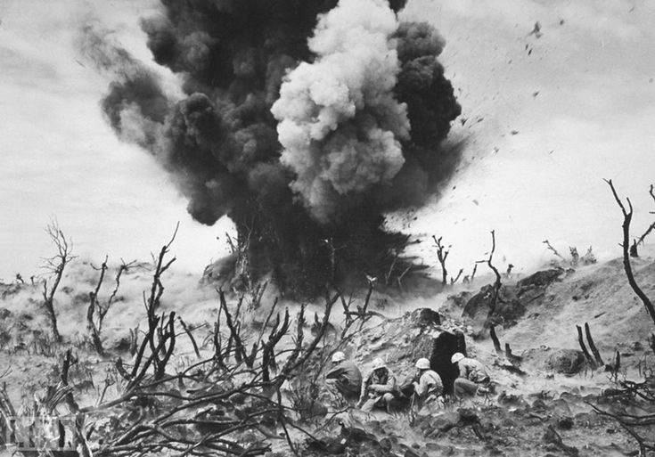10. Iwo Jima sand (Sand of Iwo Jima). Photo by Photo by W. Eugene Smith, 1945 U.S. Marines during the battle of Iwo Jima in the spring of 1945