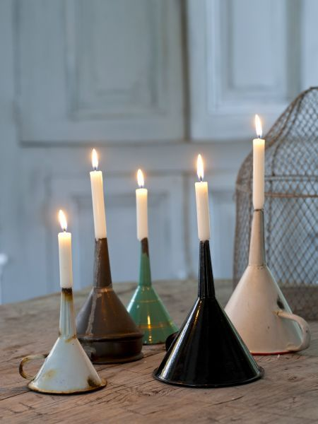 CANDLE STICKS: This is a great idea! Enamel funnel as a candlestick