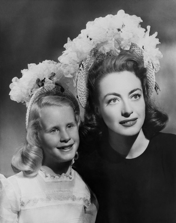 Joan and Christina Crawford in matching hats.
