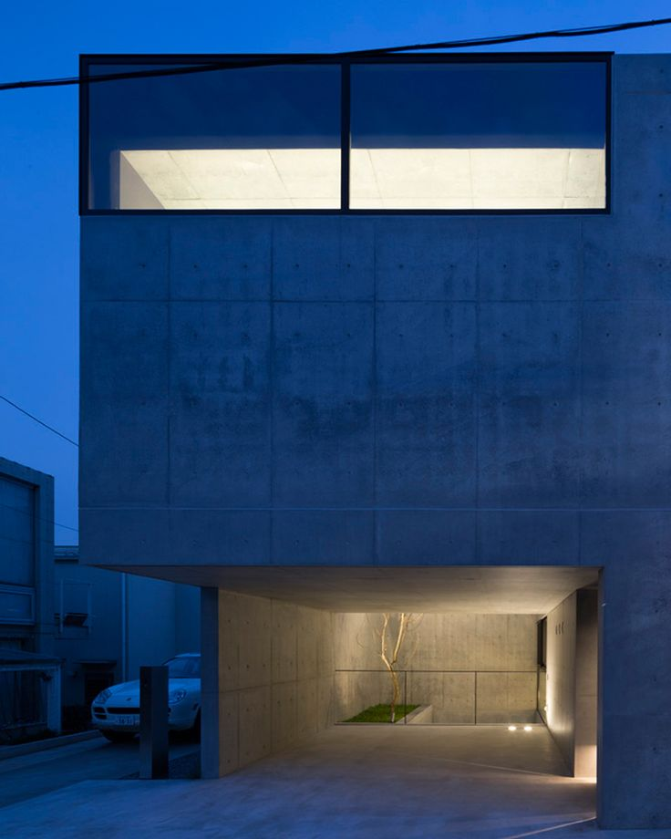 apollo architects forms garage with an overhang in minimalistic grigio house in tokyo