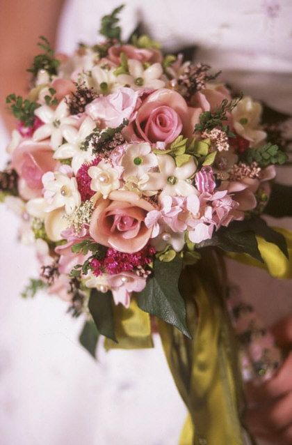 Notice all the real gems in the pink Innocence bouquet.  Everyone is a real gemstone in the finest cuts reflecting brilliant light. The bouquet will last a lifetime without a glass dome.
