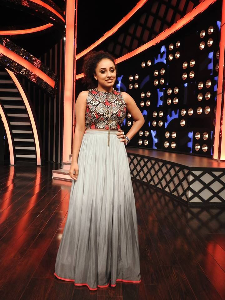 Pearle Maaney in grey and red indie themed crop top and skirt costume by paislee